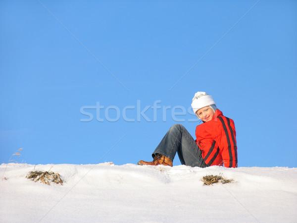 Sitting on snow Stock photo © zastavkin