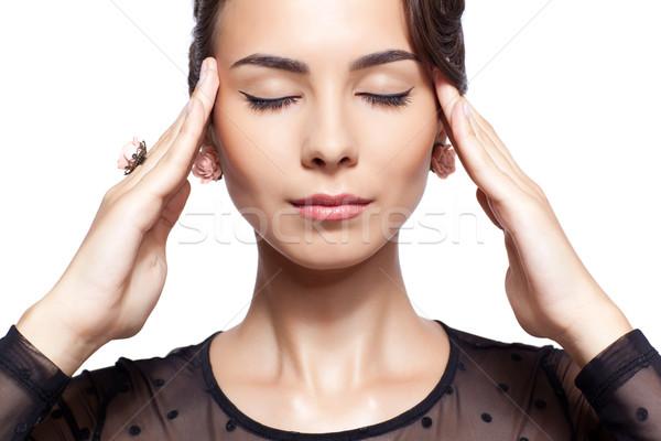 Young woman with headache Stock photo © zastavkin