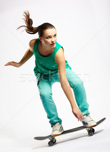 Skateboarder girl Stock photo © zastavkin