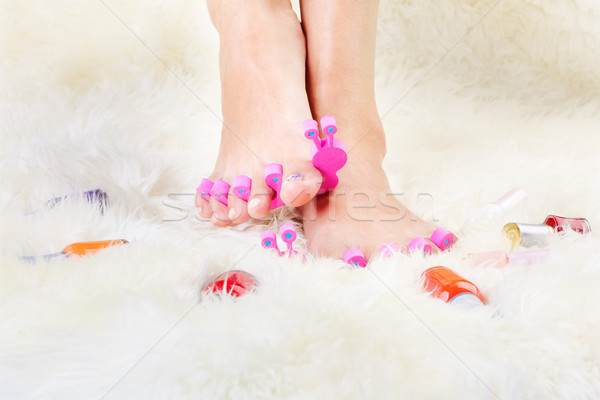 feet in toe separators Stock photo © zastavkin