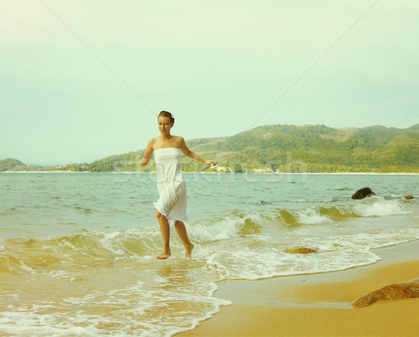 Instagram colorized vintage girl on beach portrait Stock photo © zastavkin