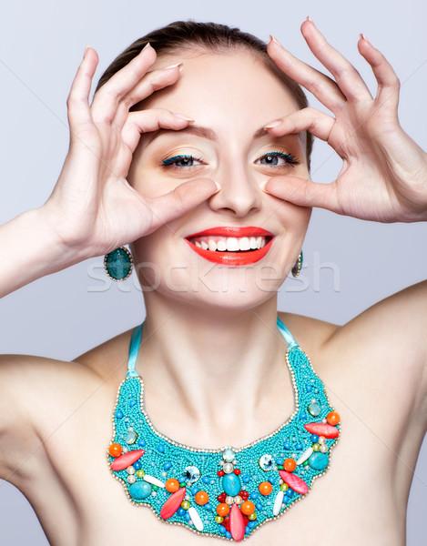 Hermosa mujer rubia bijouterie gris manos ojos Foto stock © zastavkin