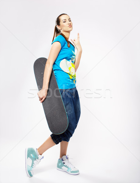 girl with skateboard Stock photo © zastavkin