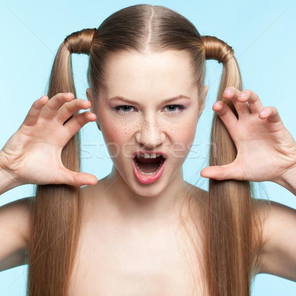 aggressive freckled girl Stock photo © zastavkin