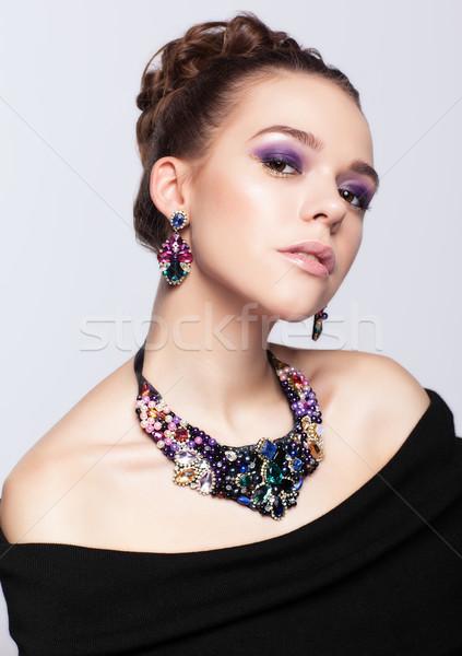Fiatal nő csecsebecsék szürke fekete ruha arc divat Stock fotó © zastavkin