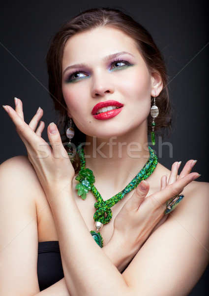 Beautiful young woman in necklace Stock photo © zastavkin