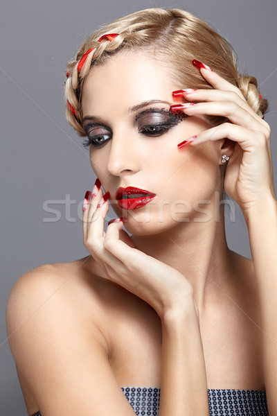 Stock photo: Young woman with red nails