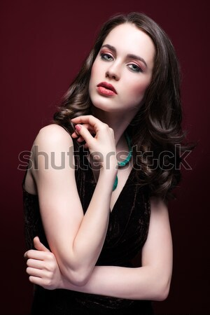 Young beautiful woman in black dress with green pistachio colour Stock photo © zastavkin