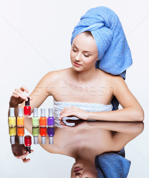 Woman with nail varnish Stock photo © zastavkin