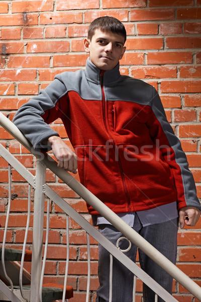 Jovem bonito cara retrato posando vermelho Foto stock © zastavkin