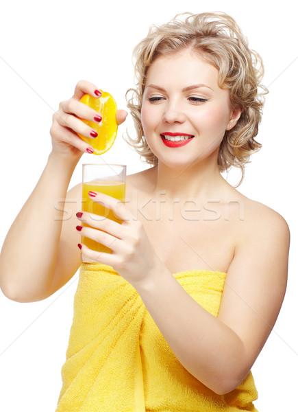 woman squeezing out orange Stock photo © zastavkin