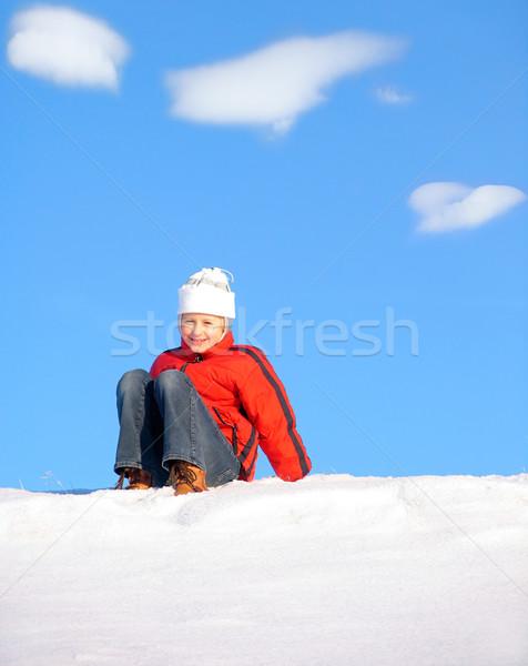 Girl sitting on snow Stock photo © zastavkin