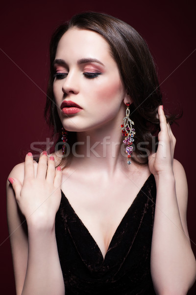 Young beautiful woman in black dress on red marsala background Stock photo © zastavkin
