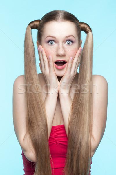 Surprised girl in red dress Stock photo © zastavkin
