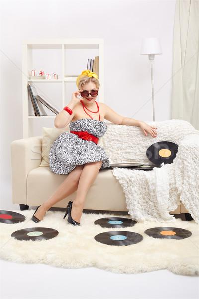 blonde woman with vinyls Stock photo © zastavkin