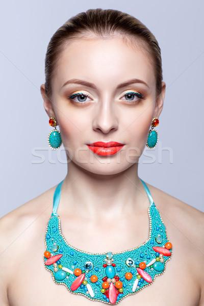 Gyönyörű szőke nő csecsebecsék szürke nő lány Stock fotó © zastavkin