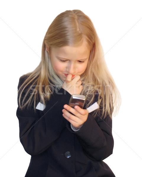 Girl dialing phone number Stock photo © zastavkin