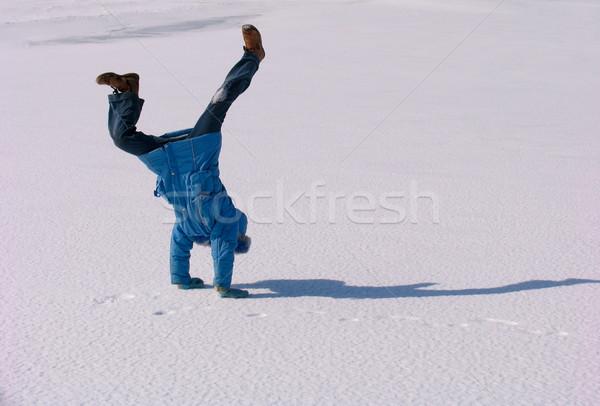 Cartwheel on the snow Stock photo © zastavkin