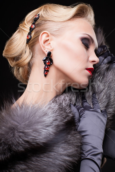 Blonde woman in fur Stock photo © zastavkin