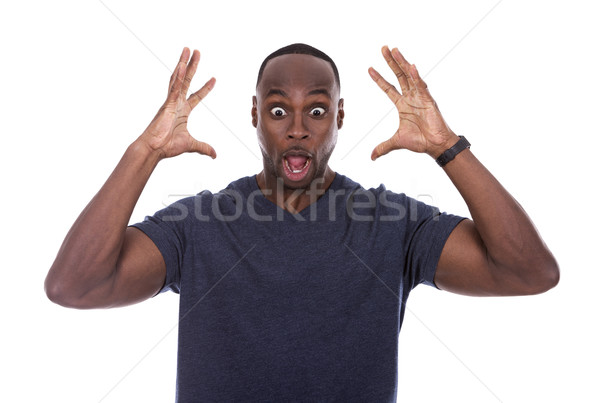 handsome black man shocked with excitement Stock photo © zdenkam