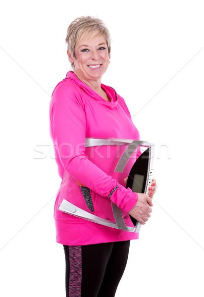 Fitt nő tart mérleg kaukázusi középkorú nő Stock fotó © zdenkam