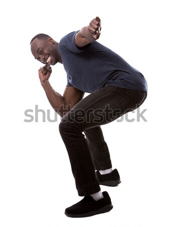 handsome black man thrilled with excitement Stock photo © zdenkam