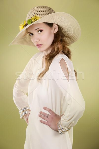 Tavasz nő visel kalap virágok világoszöld Stock fotó © zdenkam
