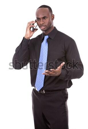 Knap zwarte zakenman jonge zakenman mobieltje Stockfoto © zdenkam