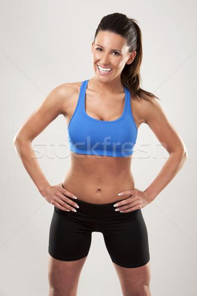 Fitnessz nő fitnessz modell barna hajú visel kék Stock fotó © zdenkam