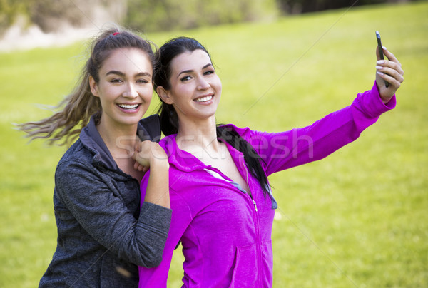 two fit women taking selfie together Stock photo © zdenkam