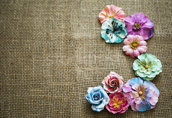 spring paper flowers on sack texture Stock photo © zdenkam