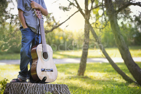 anonymous little boy with guitar Stock photo © zdenkam
