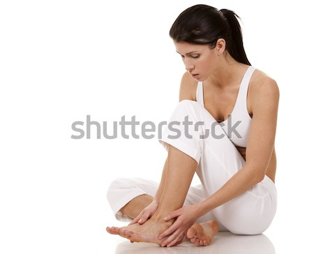 Pieds douleur brunette blanche isolé Photo stock © zdenkam