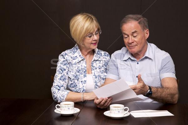 Pár néz számla nyugdíjas ül asztal Stock fotó © zdenkam