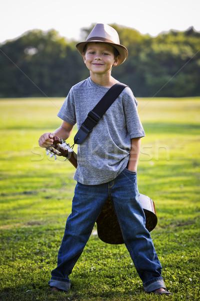 Portré kicsi fiú gitár park kint Stock fotó © zdenkam