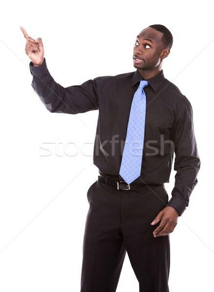 handsome black man pointing Stock photo © zdenkam