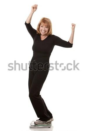 женщину Постоянный масштаба веса белый Сток-фото © zdenkam