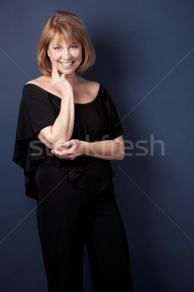 Előkelő érett nő visel fekete sötét kék Stock fotó © zdenkam