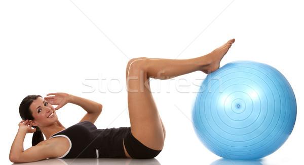 Abdominális testmozgás női fitnessz modell testmozgás Stock fotó © zdenkam