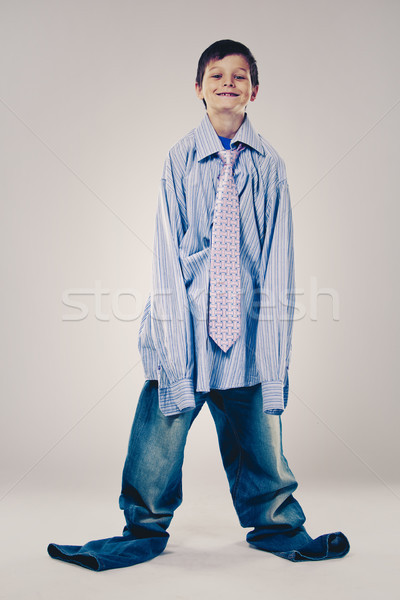 funny boy wearing Dad's clothes Stock photo © zdenkam