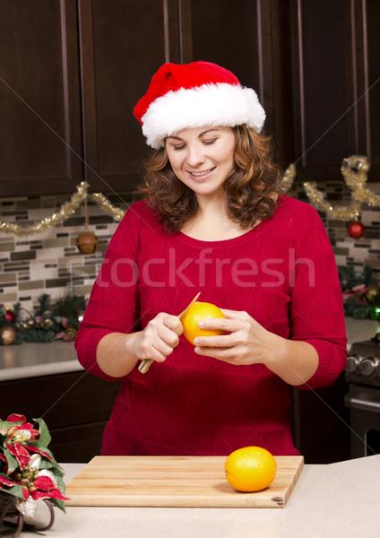 woman peeling orange Stock photo © zdenkam
