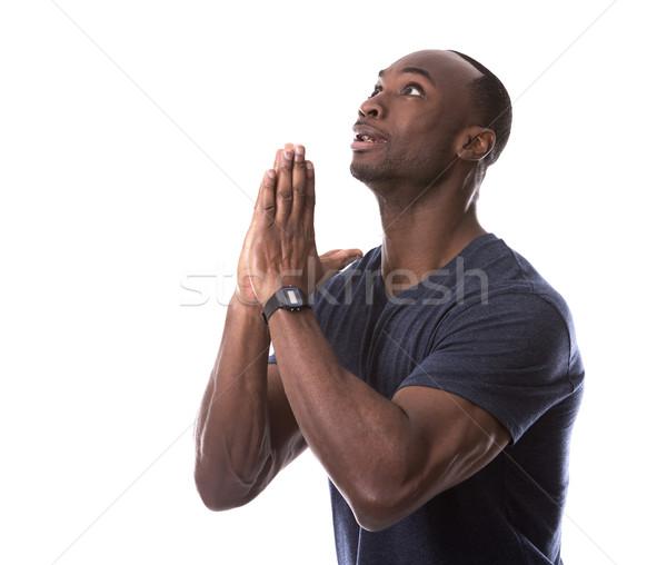 Yakışıklı siyah adam dua eden genç korkmuş gündelik Stok fotoğraf © zdenkam