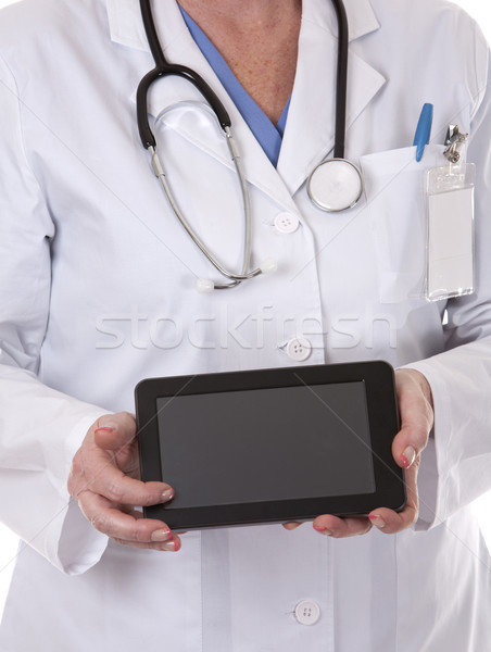 Stock photo: female doctor using tablet