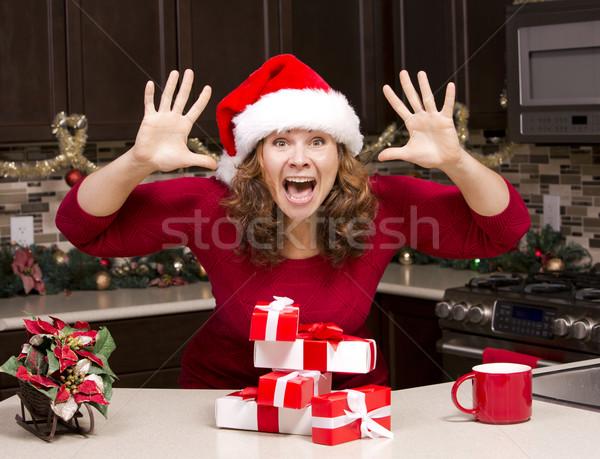 thrilled woman during Christmas Stock photo © zdenkam