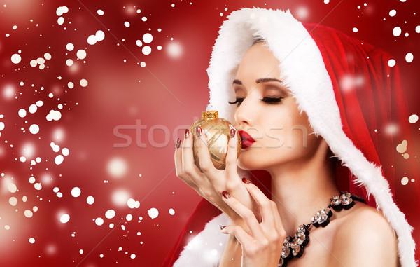Gyönyörű karácsony nő előkelő mikulás tart Stock fotó © zdenkam