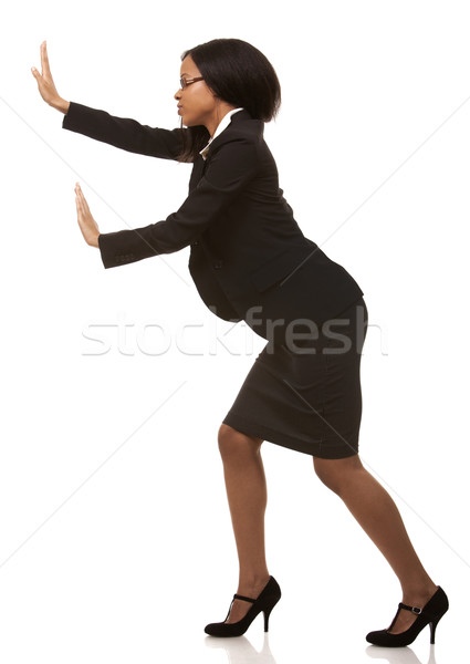 Femme d'affaires poussant invisible objet belle femme Photo stock © zdenkam
