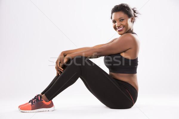 Fiatal nő afroamerikai nő visel fitnessz fehér Stock fotó © zdenkam