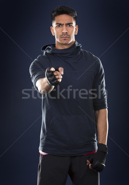 fitness east asian man on dark blue background Stock photo © zdenkam