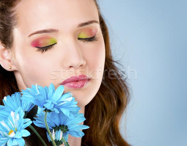 Virág nő fiatal tart kék lány Stock fotó © zdenkam