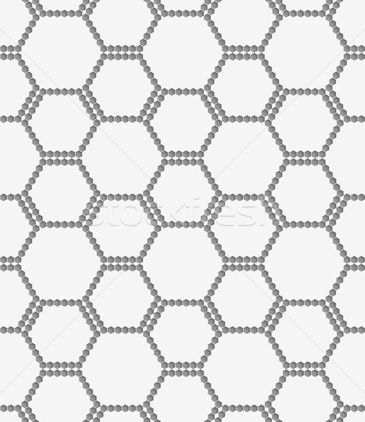 Stock photo: Perforated paper with hexagons forming bee grid